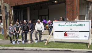 Lori Overmyer, Joe Reep, Greg Gorrell, Rosemarie Donley and Steve Englet participate in a ceremonial groundbreaking Wednesday for the new location of Associated Charities.